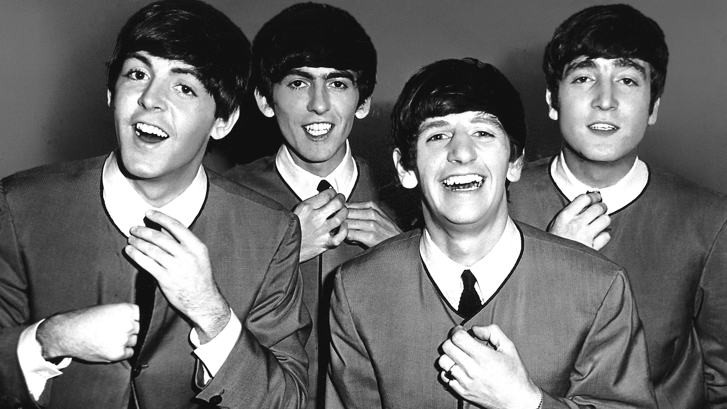 FILE - OCTOBER 5: 50 Years Since The First Beatles Single Released: A Look Back At The Beatles A group portrait of the Beatles, straightening their ties, backstage at the Odeon Cinema in Luton on 6th September 1963. (L-R) Paul McCartney, George Harrison, Ringo Starr, John Lennon. (Photo by Tom Hanley/Redferns)